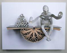 Reader with Scrolls on Claybord Original Sculpture door Kenjio