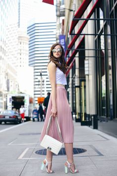 Crop top, pleated midi skirt and metallic accessories