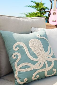 Add a luxe touch to poolside or patio furniture with Pier 1's collection of UV-resistant outdoor pillows. Channeling an oceanic vibe, this blue beauty features an elaborately embroidered octopus in a contrasting shade of shell white. Together, the pair is obviously indigenous to any well-decorated garden or yard.
