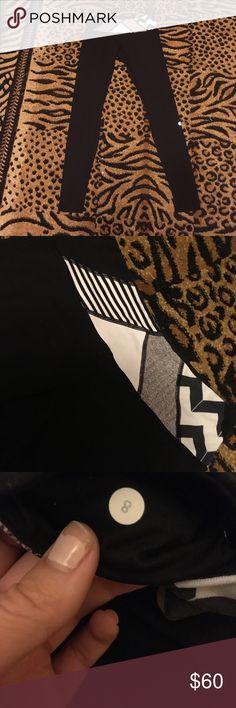 Lululemon athletica reversible yoga leggings Lululemon athletica black yoga leggings with gray and black pattern waist. Reversible to plain black. Slight wear and piling..pattern is a little faded but overall good condition! lululemon athletica Pants Leggings