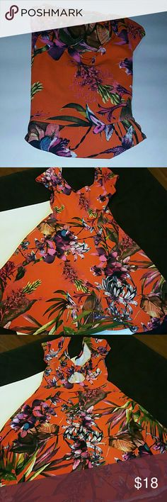 "**Orange Floral Bow Back Skater Dress** Brand new without tags.   Size is Medium  58% Polyester, 37% Rayon, 5% Spandex   Very stretchy   Colors are orange, yellow, pink, white, purple, green, blue, black  If you don't like the price please use the offer button.  If you have any questions please ask.  Sorry no trades   Have an amazing day!   ""Great Sense of Style"" pretty young thing Dresses"