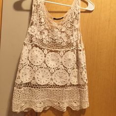 Ethnic Boho Crochet Tank Top Wear as a summery tank top, under a sweater, or even as a swimsuit coverup! Super cute with a boho look, in amazing condition, only worn once to a Fourth of July fair!! This top has absolutely no flaws! Smoke free home! (: (this top is not UO, but the brand was not listed and this top is extremely similar to their clothing style!) Urban Outfitters Tops Tank Tops