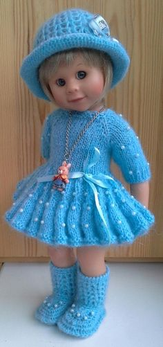 Such pretty clothes on a sweet doll