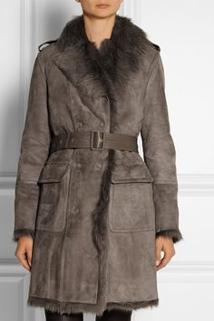 Burberry London....Leather trimmed shearling coat...essential for the upcoming season