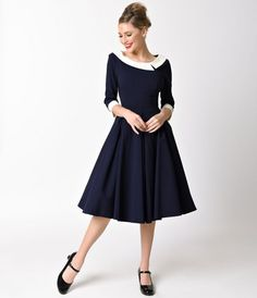 Prim and paramour go hand in hand, dears! A lovely navy blue swing fresh from The Pretty Dress Company, the Mistress dress is elegantly structured in a subtly woven stretch fabric and cast in a sensible swing silhouette. The charming three-quarter notched