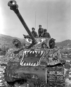 Korean War.From left to right, Cpl. John T. Clark, Cpl. James E. Kishbough, Sgt. Frank C. Allen, Sgt. Theodore R. Liberty, and Cpl. William J. Bohmback prepare to advance along the Han River area, Korea, in their M4A3E8 tank during the offensive launched by the 5th RCT against the enemy forces in that area. U.S. Department of Defense photo
