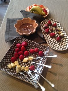 We simplified chocolate fondue by serving dipping chocolate (no need to heat it!) with some cut up fruit. It was so easy we served it during a studio meeting.