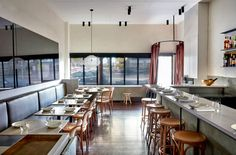 Anchovy by Fiona Lynch reflects the restaurant's Asian Australian cuisine, expressed through layered and rich materials offset with minimal detailing.