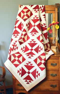 Two-color quilts are much sought after by quilt collectors, like Lincoln's Delight by Nancy Mahoney. You can make your own scrappy red and white quilt using prints from your stash or use a coordinated collection of fat quarters. Download a free size chart offering crib- and king-size options!