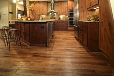 Wood floor that's not red/brown or yellow/brown . . . just a good medium brown -- Hickory Saddle