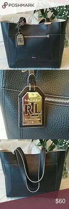 Ralph Lauren purse Black leather Ralph Lauren purse tan inside lining shoulder straps large tote purse matching logo chain hangs off the side of the strap zipper in the front and 1 inside pocket three pen marks inside of the purse still in great condition only used a couple times smoke-free pet-free home open to all reasonable offers. Ralph Lauren Bags Totes