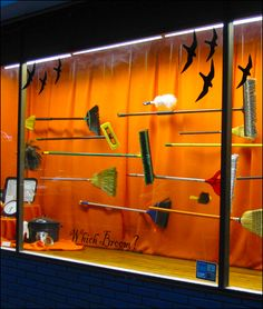 Window Display - Which Broom - Cole Hardware. It is obviously advertising for halloween with the coloured background, however, i think it gives off the sense of Harry Potter. Halloween Window Display, Halloween Displays, Visual Merchandising, Store Window Displays, Autumn Window Display Retail, Autumn Displays, Display Windows, Retail Displays, Store Front Windows