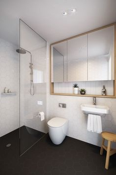 Floor to ceiling shower screen. Add a niche in wall. Love the timber around the mirror and additional niche shelving. Add double sink & move toilet. Change colour of floor tiles to a charcoal grey.