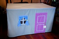Girlie side of playhouse table tent. -- instructions given for making this two sided tent (a boy's entrance and a girl's entrance) from thrift store finds.