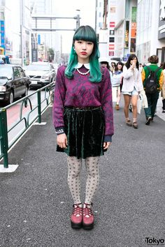 Patterned top, a dark green velvet skirt, graphic tights, and Tokyo Bopper platform shoes
