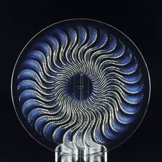 René Lalique Glass 'Actinia'. A striking early 20th Century Art Deco glass plate decorated with a geometric pattern of swirling fronds exhibiting good clear and opalescent colour, signed R. Lalique France.