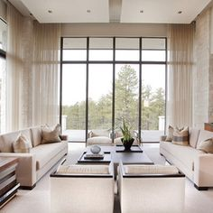 sheer curtains soften this stark room