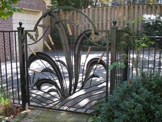 What a great gate, just wish it has a garden planted beyond it to real show off the artistry. Or a path to a pond might be even better!