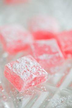 Turkish delights: ingredients 8 oz. water 1 oz. gelatine 14 oz. sugar ¼ tsp. citric acid ½ tsp. vanilla essence 2 tsp. triple-strength rose water pink food colouring - optional 2oz. powdered sugar 1 oz. cornflour