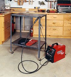 """How to Build a Metal Welding Table - Easy to make.  Couldn't find a full sheet of steel for the top, so welded together several lengths of 3"""" bar - works decently."""