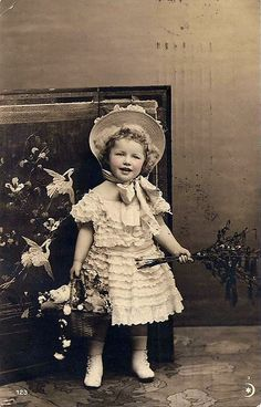 Little girl in her Easter dress and bonnet holding her basket ~*~ This is such a sweet old photo!