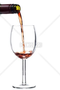 pouring of wine on a glass - Pouring of wine on a glass in a macro image
