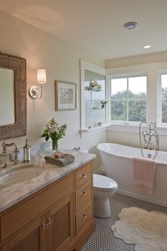 Waterfront bathroom (Hutker Architects) - love the frosted glass wall w/shelves; windows; thick molding; mirror; sconces; tub, striped bath mat; floor (don't love the wood vanity)