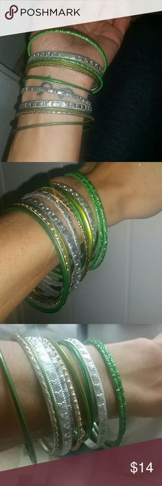 Beautiful Indian sparkly Bangles 12 Bangles mixed between a silver green and gold. The silver r the thicker ones . the green and gold compliment in between if you like to wear it that way to offset the thicker ones. That's how I like to wear it and I have others that I want to post because I ended up I'm buying a little bit too many different sets because I didn't know which ones I was going to like so I'm mixing&matching now 2come up with a good option of ingredients;) free gift included…