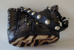 Chelsea is a StageCoach Bag created from a vintage cowboy boot.  She has a soft cowhide bottom and her lining is a leopard print.  Very beautiful.  www.stagecoachbagsandcollectibles.com Small Places, You Bag, Airplane, Cowboy Boots, Bucket Bag, Chelsea, Trips, Purses, Summer