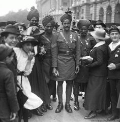 Indian Troops in Europe, WWI  Parisians surround and cheer Indian soldiers after the Bastille Day Parade.