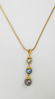 Three colors of pearls set in a graceful pendant. This piece was made by artist Julie Rauschenberger and is available at Studio Jewelers in Madison WI. Jewelry Crafts, Jewelry Art, Jewlery, Pearl Necklace, Pendant Necklace, Lampworking, Pearl Set, Ancient Jewelry, Abstract Shapes