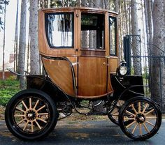 Carriage Car. Two-seater, but w/extended cab to include place for driver.   (steampunktendencies:  1905 Woods Electric)