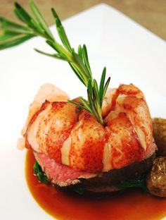 An elegant Surf and Turf dish, Lobster Tail and Prime Rib!