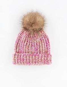 Boden Chunky Knit Hat. This hat grabs attention for all the right reasons with its statement furry pom-pom and pop stitch. Finish the look with the matching scarf and mittens.