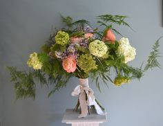 Wild style and rustic bouquet made of Juliet Roses, Ranunculus, Viburnum, Lilac and ferns. Created by Eden Blooms
