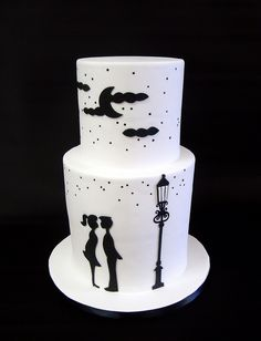 "Black & White Kissing Couple Silhouette Wedding Cake by Berliosca Cake Boutique --- This just makes me want to sing ""Strangers In The Night!"" Great for Rat Pack wedding reception."