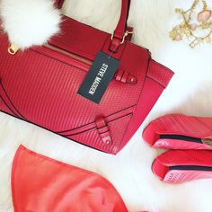 "Red/Gold hardware Steve Madden Satchel. The purse handles for easy carry over the shoulder. An extra adjustable strap is attached, which can be taken off if desired. The purse has three interior pockets. One that closes with a zipper, and one pocket on the outside backside that also closes with a zipper. Beautiful Satchel (Pom Pom not included)  Measures:  Height Approx: 11"" Length Approx(top of satchel): 18"" Interior Approx(bottom satchel): 14""  ▪️NWT No Trade  Happy Poshing ❣"