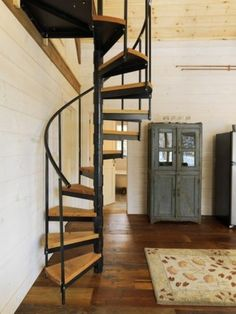 A spiral staircase is one of the … Vermont wood cabin — rustically delicious. A spiral staircase is one of the main architectural finds from a salvage shop in Vermont. Rustic Staircase, Wooden Staircases, Staircase Design, Spiral Staircases, Stair Design, Staircase Ideas, Small Staircase, Spiral Stairs Design, Stairs In Small Spaces