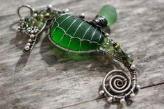 Emerald Green seahorse wire wrapped seaglass pendant.