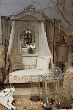 Atelier de Campagne, a dynamic trio of antiques dealers. French iron day bed Cloche Half-Tester