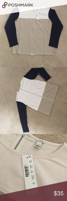 Brand New! J. Crew Color Block Cotton Sweater! Brand New! J. Crew Color Block Cotton Sweater with Zipper on back. Navy blue sleeve with cream and tan color block. Tags attached! J. Crew Sweaters Crew & Scoop Necks