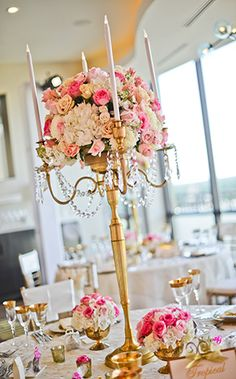 Tall centerpieces are all about elegance and class – adorn them with crystals . Tall centerpieces are all about elegance and class – adorn them with crystals to make them the focal point of your décor. Candelabra Centerpiece, Tall Wedding Centerpieces, Wedding Flower Arrangements, Reception Decorations, Floral Arrangements, Table Decorations, Wedding Spot, Space Wedding, Wedding Table
