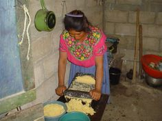 Traditional stone corn grinder, called Ka, is a daily routine in the process of making tortillas in Guatemala.  See more about Masons on a Mission at http://www.mha-net.org/docs/v8n2/docs/mom-2005report.htm#