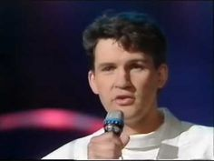 ▶ Eurovision 1987 Ireland - Johnny Logan - Hold me now - YouTube This is my favorite song by Johnny Logan!! Gosh  I remember watching this too.... 80's fashion !! lol