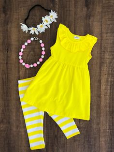 Sunshine Yellow Stripe Capri Set This sunshine yellow stripe capri set is so cute and trendy! Perfect for Spring and Summer around the corner! This set is made out of soft cotton/spandex.