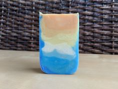 Tried for the advanced category. Mixed up 21 different colors to do a double ombre effect. Mixed what was left of two scents that I know don't accelerate... They accelerated. Not a shimmy at all but got it in the mold, it smells great, and it looks like a sunrise over the mountains. Ombre Effect, Pillar Candles, Different Colors, Sunrise, Challenge, Soap, Skinny, Mountains, Thin Skinny