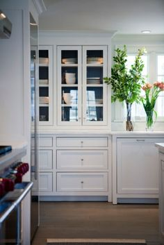white kitchen, glass fronts with dark painted backs