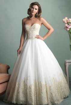 Allure Bridals. Strapless English net ballgown with gilded lace applique