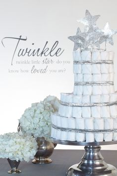 Twinkle Diaper Cake. Four-tiered diaper cake with 100 HUGGIES® Pure & Natural Diapers with silver ribbon and star accents.