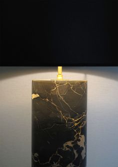 Nero Portoro marble is extracted from quarries in the region of La Spezia in Liguria Italia. Its deep and bright black color is veined gold and grey. This rare and decorative marble is used since antiquity. Made by hand by turning technique for the cylindrical pieces. Each lamp is a unique piece. www.dayglow.fr Marble Collection, Marble Lamp, Day Glow, Turning, France, Bright, Deep, Lighting, Stone